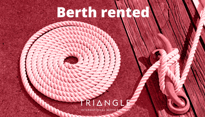 A coil of rope on the dock. Berth rented