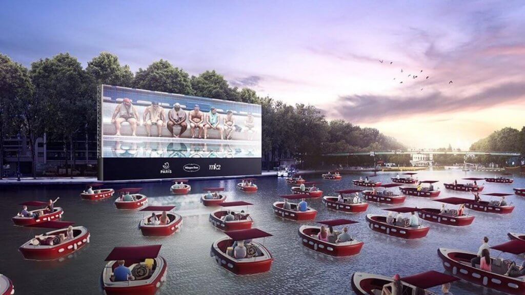 Boats on a river watching a cinema screen in Paris